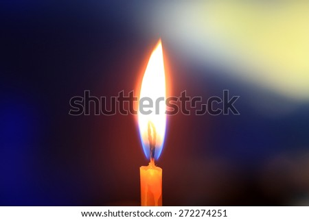 Flame of candle light in darkness  - stock photo