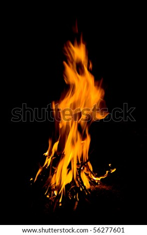 Flame of fire in darkness - stock photo