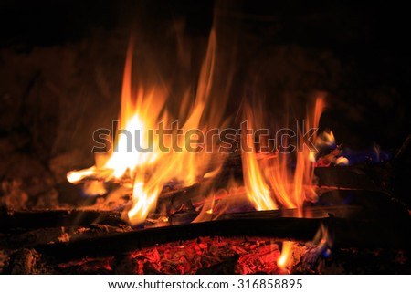 flame of hot fire in dark - stock photo