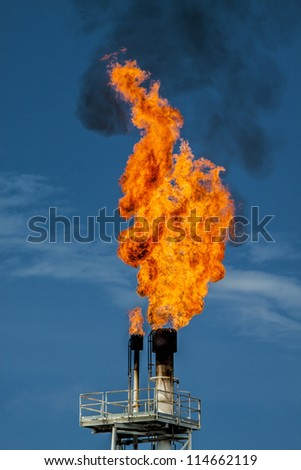 Flame on rigs in the gulf of thailand - stock photo