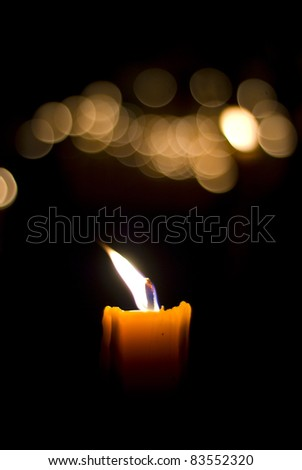 Flame to light a candle in the dark. - stock photo