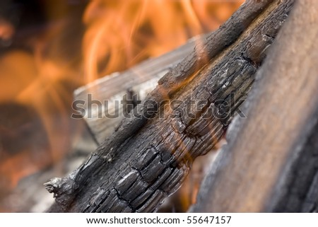 Flame with embers outdoors photo - stock photo