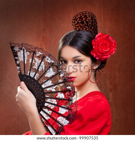 Flamenco dancer Spain woman gypsy with red rose and spanish hand fan - stock photo