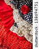 Flamenco dresses in red and blue with spot with red rose typical from Spain Espana - stock photo