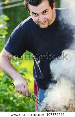 Flames grilling a steak on the BBQ - stock photo