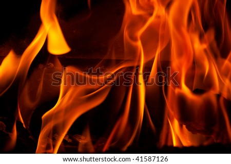 Flames in a fireplace in anybody house at cold weather