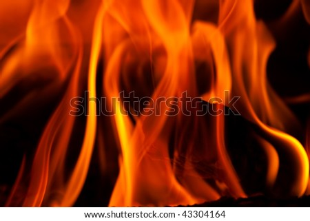 Flames in a fireplace in anybody house at cold weather - stock photo