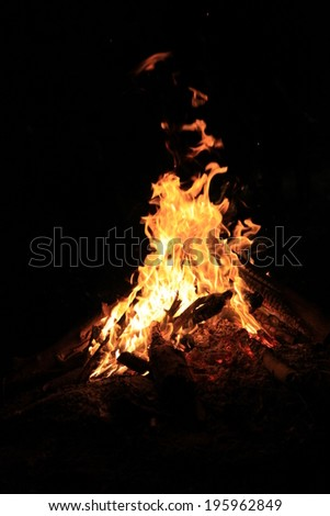 Flames of a campfire in a night - stock photo