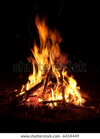 Flames of a campfire in the night - stock photo