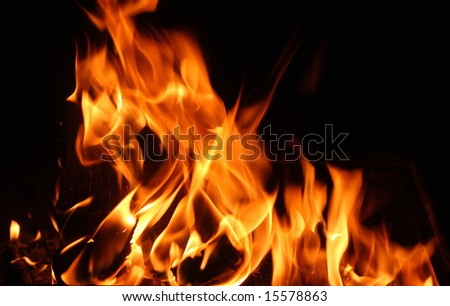 flames of a fire in the dark - stock photo