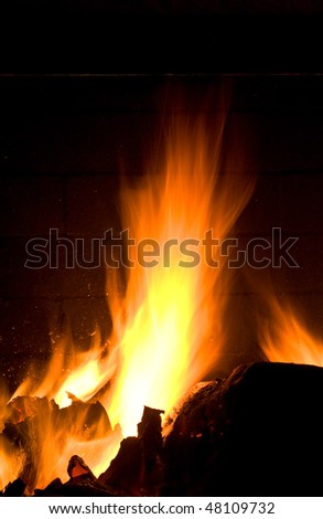 Flames of Fire in a Fireplace against a black Background