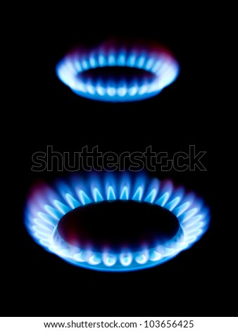 Flames of gas isolated on black background - stock photo