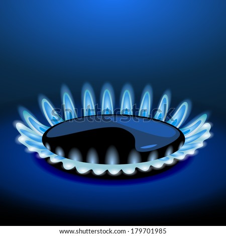 Flames of gas stove in the dark - stock photo