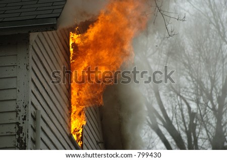 flames out of window - stock photo