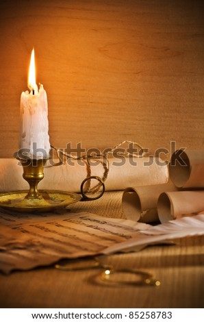 flaming candle and antic musical notes