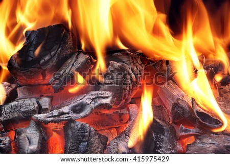 Flaming Charcoal In BBQ Grill Pit Isolated On Black Background - stock photo