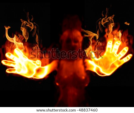 Flaming fiery hands reaching out of the gloom of night. - stock photo