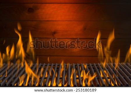 Flaming Hot Barbecue Grill Background  - stock photo