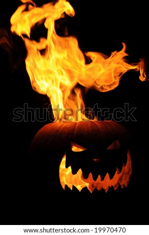 Flaming Jack O Lantern Pumpkin - stock photo