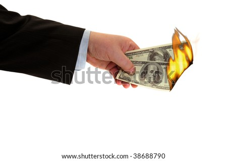 Flaming money in hand, isolated on white background - stock photo