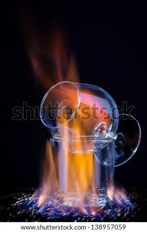 Flaming Sambuca and coffee beans. - stock photo