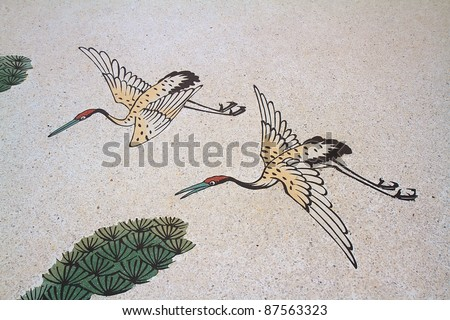 Flamingo bird  painting on a wall in Chinese temple - stock photo