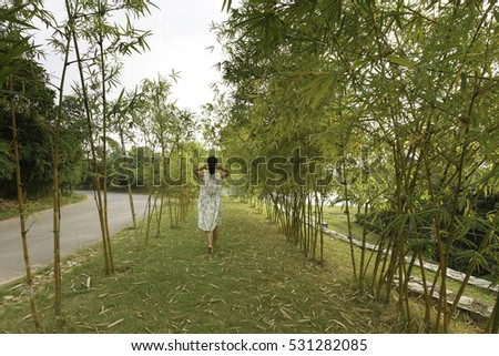 Flamingo Dai Lai, Vinh Phuc province, Vietnam - October 13, 2016 :woman relaxing walk in the bamboo forest at Flamingo resort Dai Lai, Vietnam