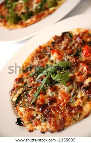 ... and bacon tart with some rucola, tomatoes, parmesan cheese, cream