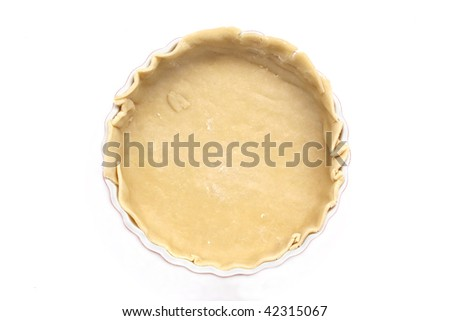 flan dish with raw pastry base before being filled to be cooked - stock photo