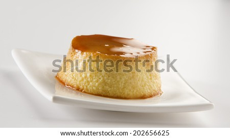 Flan on white plate - stock photo