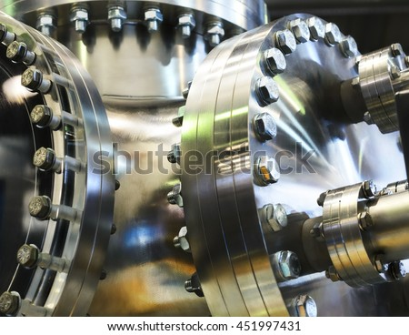 Flanged vacuum equipment. Shiny metal surface. A metal surface treated. - stock photo