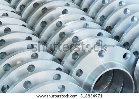 Flanges stacked in warehouse, selective focused - stock photo