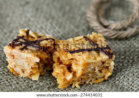 Flapjack snack bar with a chocolate decoration. - stock photo