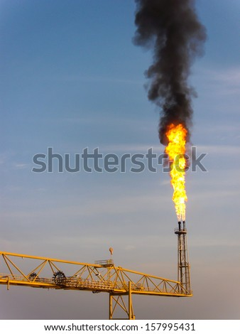 Flare burn in offshore location - stock photo