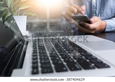 flare light, Double exposure of business man hand working  laptop computer on wooden desk as concept with social diagram