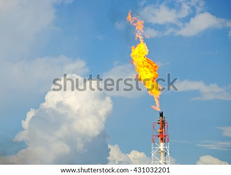 Flare stack at oil and gas Refinery Plant - stock photo