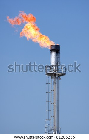 Flaring of natural gas in the oil industry - stock photo