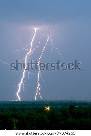 Flash at the night near the city - stock photo