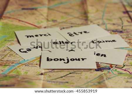 Flash cards with French words on the map of Paris - stock photo