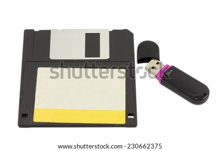 flash drive and floppy disk isolated on white background - stock photo