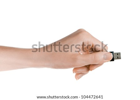 Flash drive in woman hand isolated on white background - stock photo