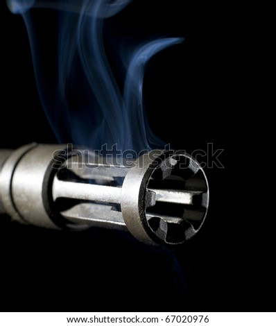 flash hider on an Ar-15 that is smoking hot - stock photo
