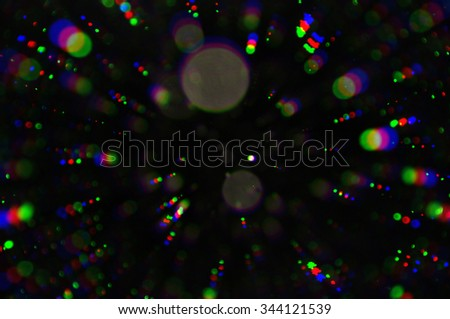 Flashing lights colorful circles blur. Abstract background.