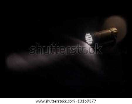 flashlight glowing on the dark - stock photo
