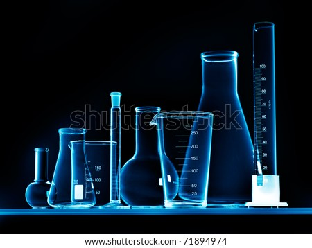 Flask with chemicals and test tubes - stock photo