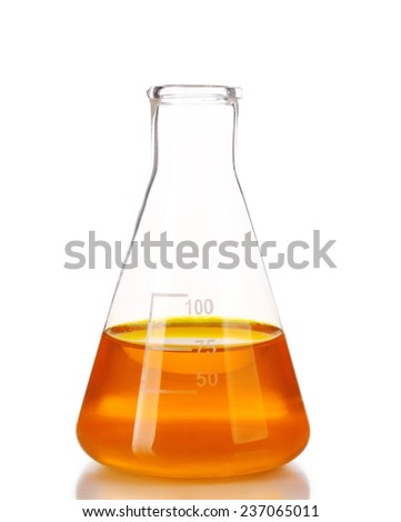 Flask with orange fluid isolated on white - stock photo