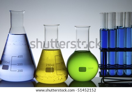 flasks and test tubes with colored liquid