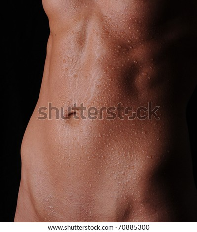 Flat Abs with Water Drops - stock photo