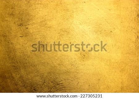 flat background, gilded gold leaf - stock photo