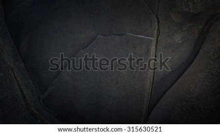 Flat Black Granite Wall Slab Background Texture With Fractures - stock photo